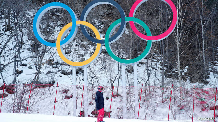FILE – The Olympic rings are seen at Jeongseon Alpine Cent