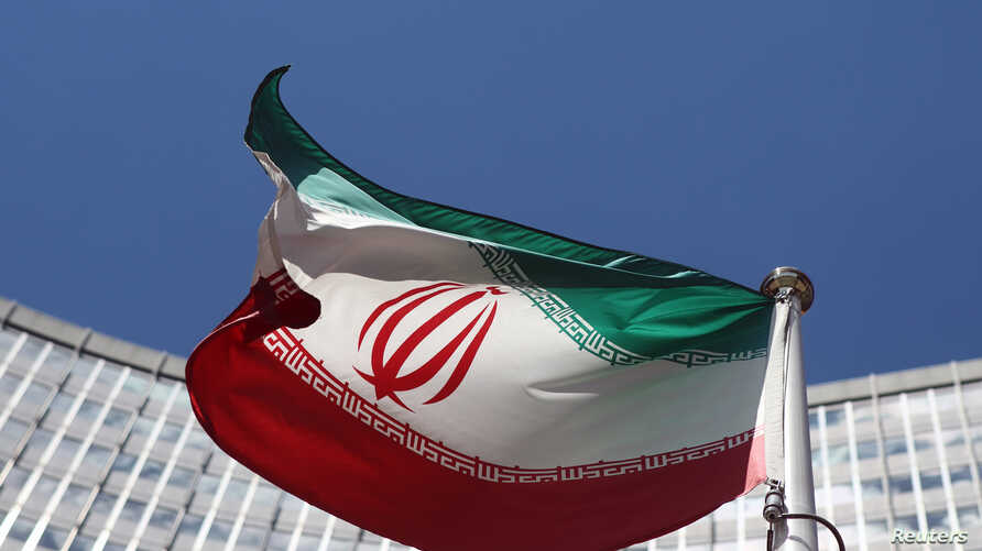 An Iranian flag flutters in front of the United Nations headquarters in Vienna June 17, 2014. Six world powers and Iran began their fifth round of nuclear negotiations on Tuesday in hopes of salvaging prospects for a deal over Tehran's disputed atomi