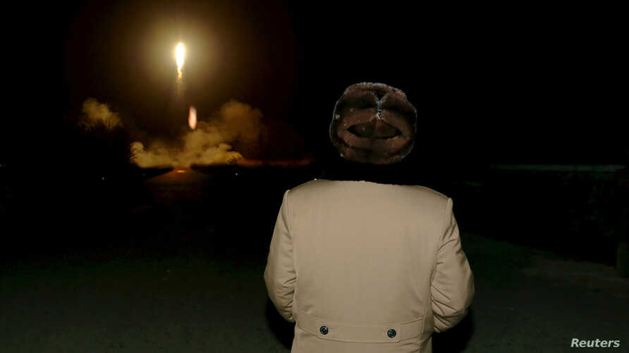 FILE - North Korean leader Kim Jong Un watches the ballistic rocket launch drill of the Strategic Force of the Korean People's Army (KPA) at an unknown location, in this undated photo released by North Korea's Korean Central News Agency (KCNA) in Pyo