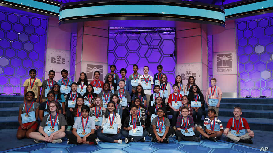 Participants with their medals to advance to the final round gathered on stage for a group photograph during the Scripps National Spelling Bee in Oxon Hill, Md., Wednesday, May 30, 2018.