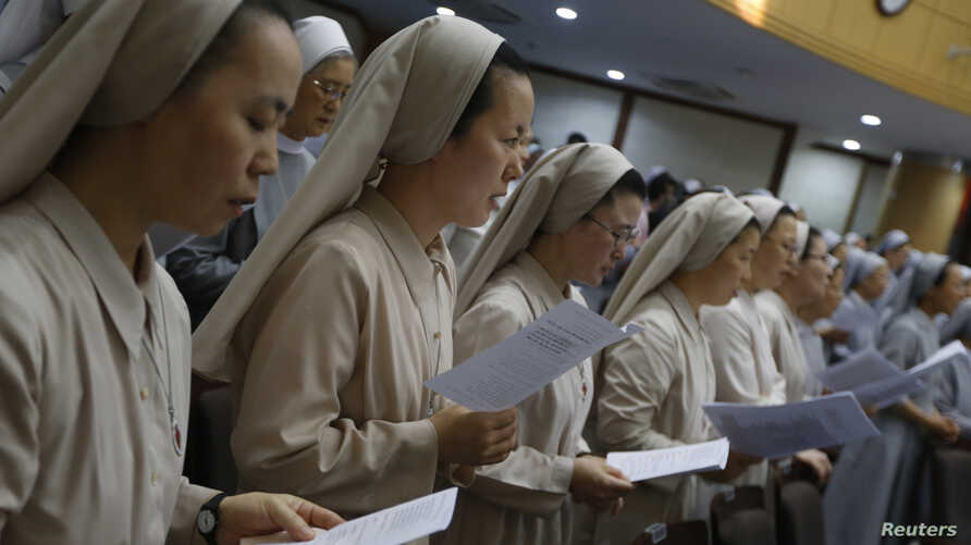 FILE - Catholic nuns attend mass at the Jesuit Apostolic Center in Seoul.