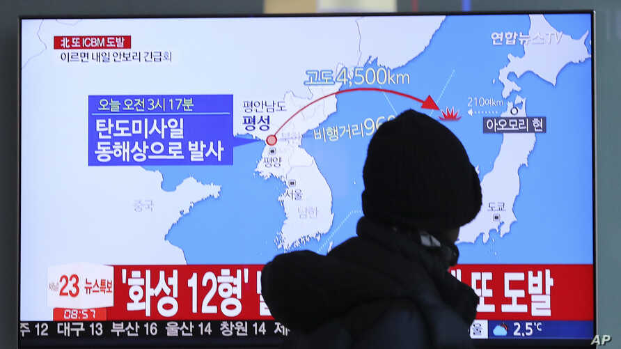A man watches a TV screen showing a local news program reporting North Korea's missile launch at the Seoul Train Station in Seoul, South Korea, Nov. 29, 2017.