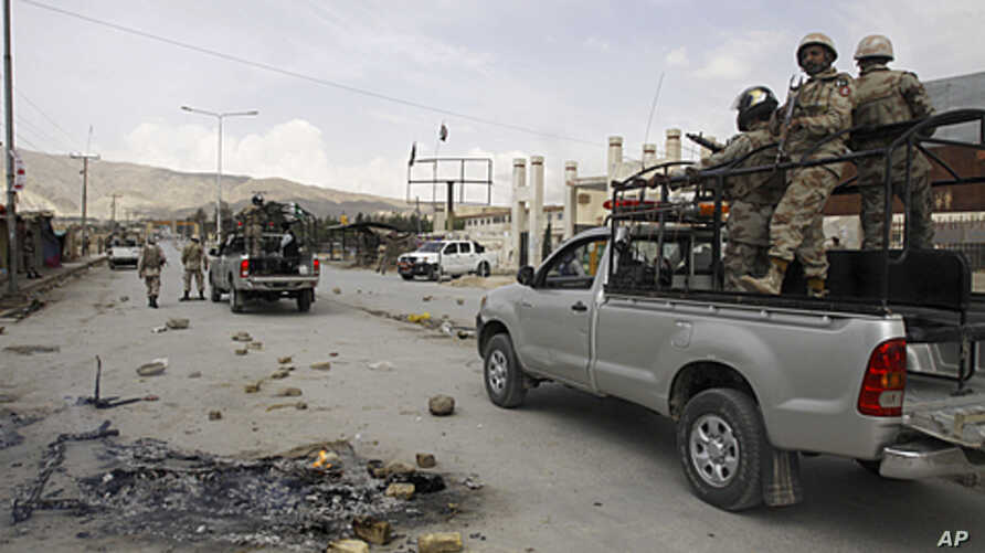 Pakistan paramilitary troops patrol at the site of an attack by gunmen, in Quetta, Pakistan, Saturday, April 14, 2012.