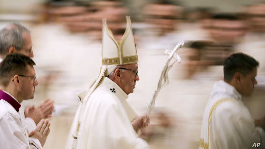 Pope Francis leaves after he celebrated Mass on the occasion of the feast of Our Lady of Guadalupe, in St. Peter's Basilica at the Vatican, Dec. 12, 2018.