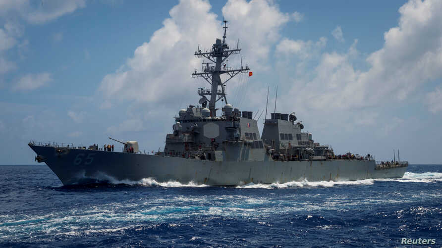 FILE - The Arleigh Burke-class guided-missile destroyer USS Benfold transits the Philippine Sea, June 14, 2018. The ship has also sailed recently through the Taiwan Strait.