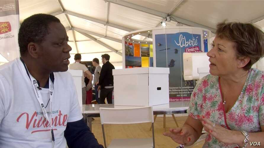 Congolese priest Mick Ngundu speaks to Veronique Couque in Caen. Their paths might never have crossed had it not been for Living Libraries.