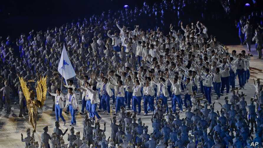 The combined Koreas flag bearer's march into the Gelora Bung Karno Stadium during the opening ceremony for the 18th Asian Games, Jakarta, Indonesia, Aug. 18, 2018.