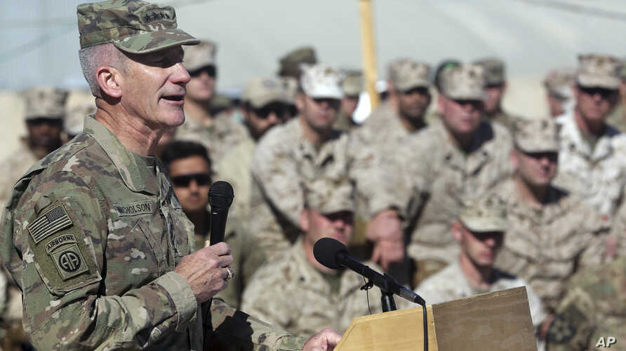 FILE - The commander of NATO and U.S. forces in Afghanistan, U.S. Army Gen. John W. Nicholson speaks during a change of command ceremony at Task Force Southwest atn Shorab military camp of Helmand province, Afghanistan, Monday, Jan. 15, 2018.