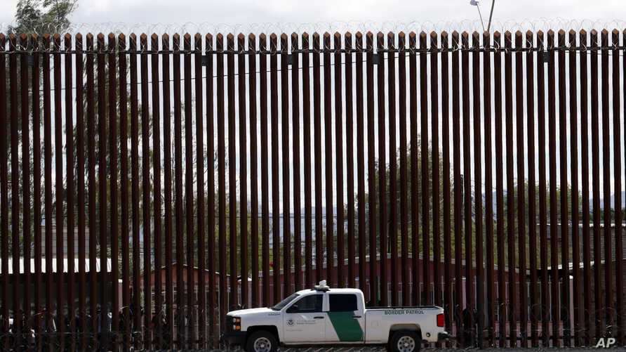 A U.S. Customs and Border Protection vehicle sits near the wall as President Donald Trump visits a new section of the border wall with Mexico in Calexico, Calif., April 5, 2019.