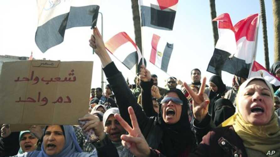 Egyptian anti-Mubarak protesters shout slogans as they march in Alexandria, Egypt, Feb 8, 2011