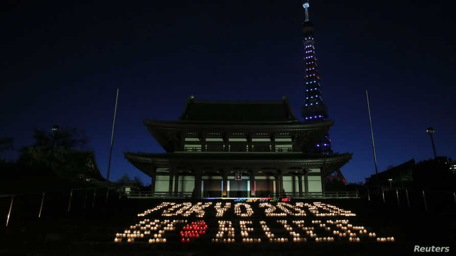 "A message reading ""Tokyo 2020 We Believe"", made up of 2,020 candles, is displayed at Zojoji temple in Tokyo September 5, 2013."
