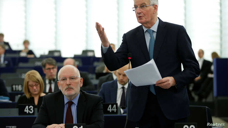European Union's chief Brexit negotiator Michel Barnier delivers a speech during a debate on BREXIT after the vote on British Prime Minister Theresa May's Brexit deal, at the European Parliament in Strasbourg, France, Jan. 16, 2019. Left is European