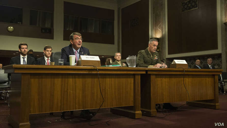 Defense Secretary Ash Carter and Marine Corps Gen. Joseph F. Dunford Jr., chairman of the Joint Chiefs of Staff, testify on U.S. military strategy in the Middle East before the Senate Armed Services Committee in Washington, D.C., Oct. 27, 2015.