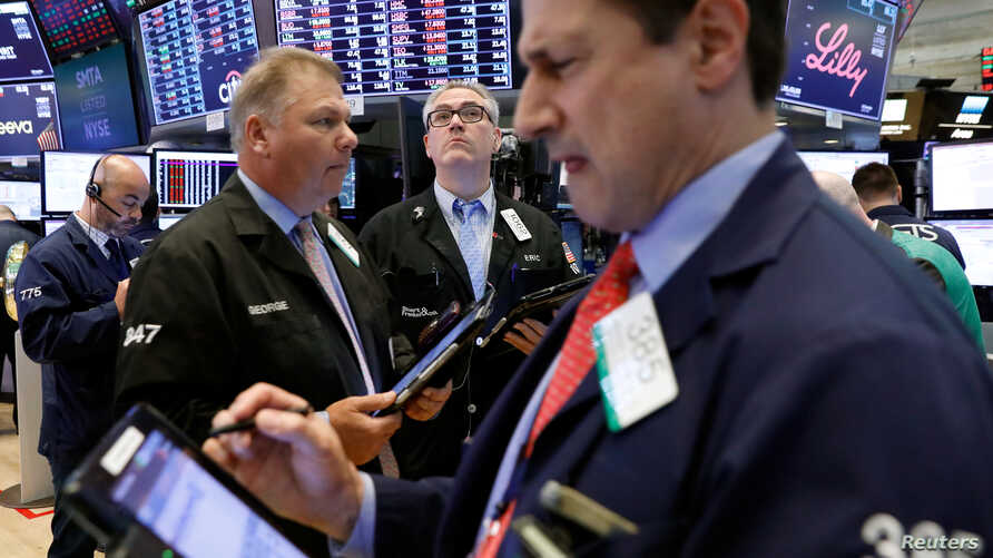 Traders work on the floor of the New York Stock Exchange (NYSE) in New York City, June 25, 2018.