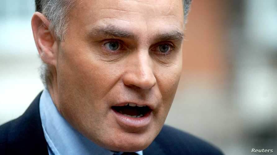 FILE - Conservative MP Crispin Blunt, pictured talking to reporters in London in 2003, leads a panel seeking access to female activists jailed in Saudi Arabia to investigate allegations of torture and sexual assault in prison.