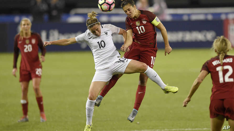 France midfielder Camille Abily, left, battles for the ball against United States midfielder Carli Lloyd, right, during the first half of a SheBelieves Cup women's soccer match, March 7, 2017, in Washington.