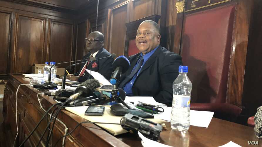 Japhet Murenje, the head of nomination court in Harare on June, 14, 2018, announces the names of the candidates  who will run for Zimbabwe's presidency in the July 30 general election.