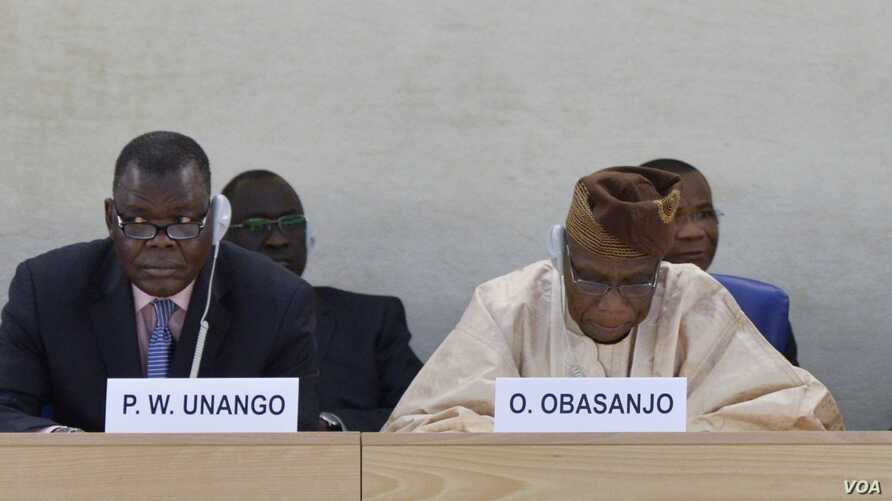 Former Nigerian President Olusegun Obasanjo (R) addresses a special session on South Sudan at the U.N. Human Rights Council on Sept. 24, 2014, as South Sudan Justice Minister Paulino Waniwilla Unango listens. Mr. Obasanjo heads a commission of inquir