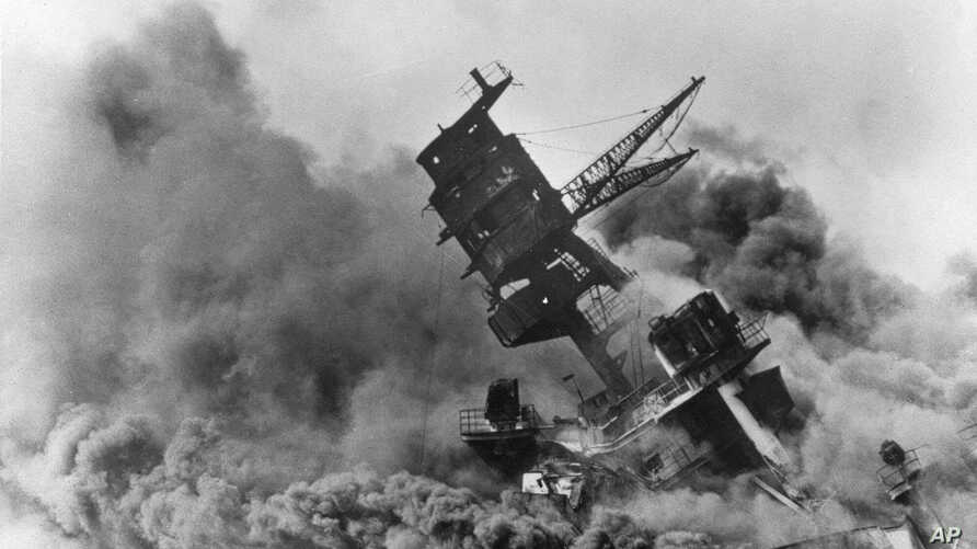 FILE - Smoke rises from the battleship USS Arizona on Dec. 7, 1941 as it sinks during the Japanese attack on Pearl Harbor, Hawaii.