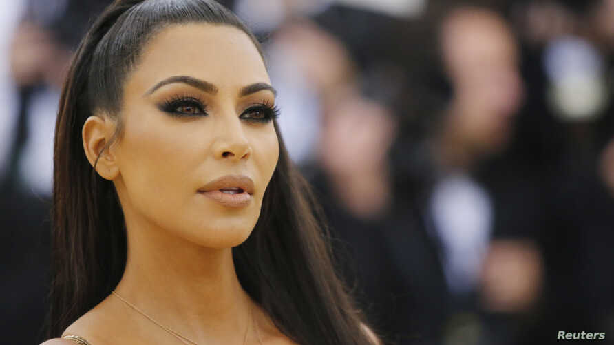 """FILE - Kim Kardashian arrives at the Metropolitan Museum of Art Costume Institute Gala (Met Gala) to celebrate the opening of """"Heavenly Bodies: Fashion and the Catholic Imagination"""" in the Manhattan borough of New York, U.S., May 7, 2018."""