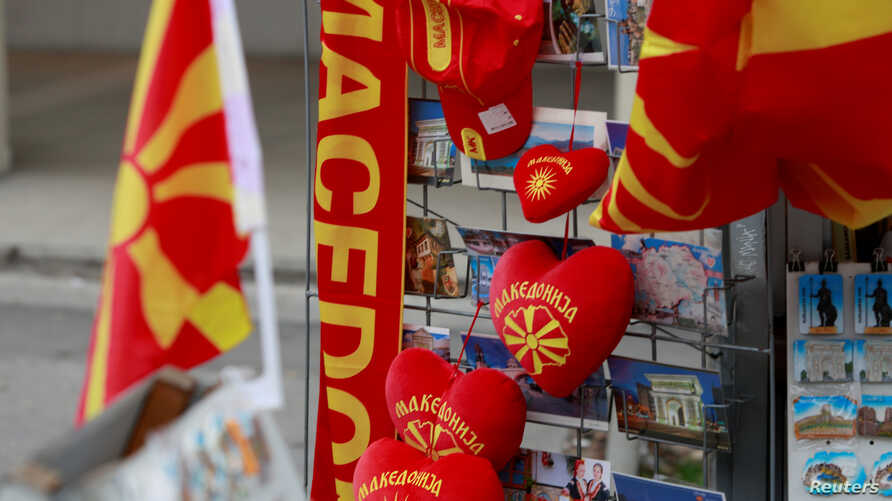 Souvenirs with the flag and name of Macedonia written on them are displayed in Skopje, Macedonia, Jan. 10, 2018.