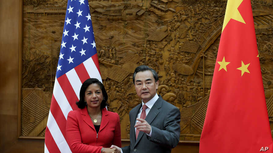 U.S. National Security Advisor Susan Rice, left, shakes hand with Chinese Foreign Minister Wang Yi at the Olive Hall before a meeting at the Foreign Ministry office in Beijing, China Tuesday, Sept. 9, 2014.  China and the U.S. need to avoid incidents