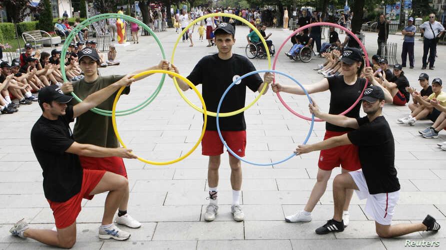 FILE - Participants perform during an event organized by Kosovo's National Olympic Committee in the capital Pristina.