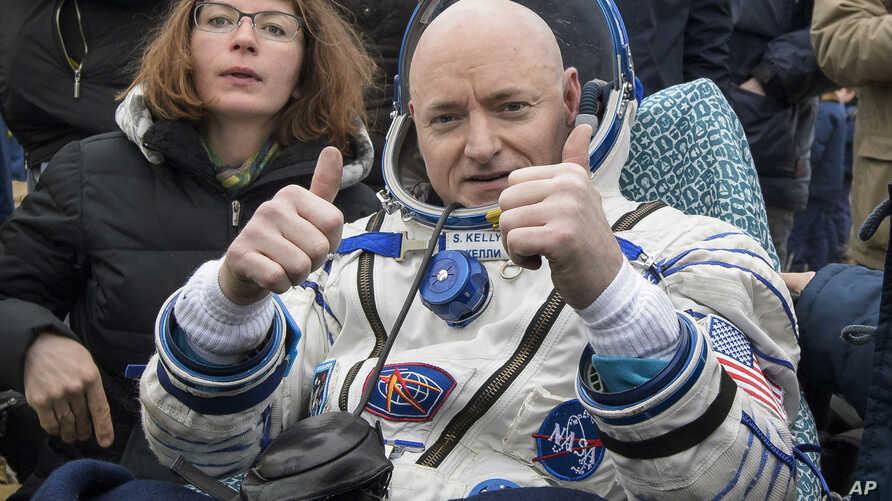 FILE - In this Wednesday, March 2, 2016, photo provided by NASA, International Space Station crew member Scott Kelly of the U.S. reacts after landing near the town of Dzhezkazgan, Kazakhstan.