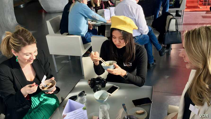 "Diners sample vegan dishes at a ""Future 50 Foods"" tasting at the Pompidou Center in Paris."