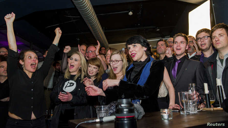 Pirate Party members react after early results of the parliamentary elections are announced in Iceland, Oct. 29, 2016. The anti-authoritarian advocates of direct democracy and digital freedom, almost tripled their vote share from 5 percent in 2013 to