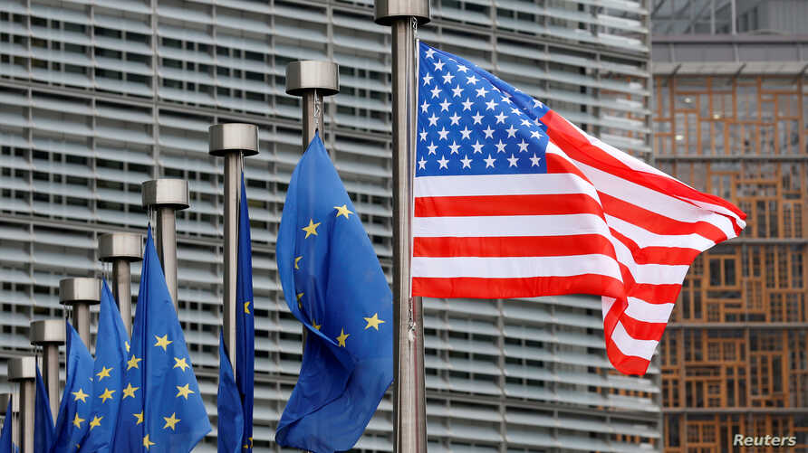 FILE - A U.S. and European Union flags are pictured during the visit of Vice President Mike Pence to European Commission headquarters in Brussels, Belgium, Feb. 20, 2017.