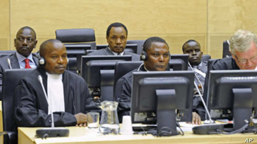 Three Kenyan suspects (back row, from L to R), William Ruto (L), Henry Kosgey (C) and Joshua Arap Sang (R), accused of crimes against humanity in their country's post-election violence in 2007-08, make their initial appearance at the International Cr