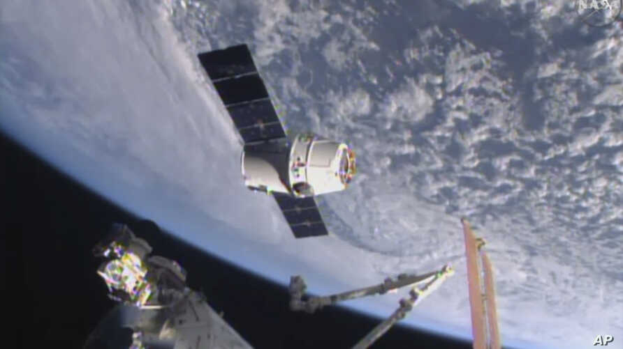 FILE - In this April 17, 2015, image from NASA-TV, the SpaceX Dragon 6 resupply capsule nears the International Space Station.