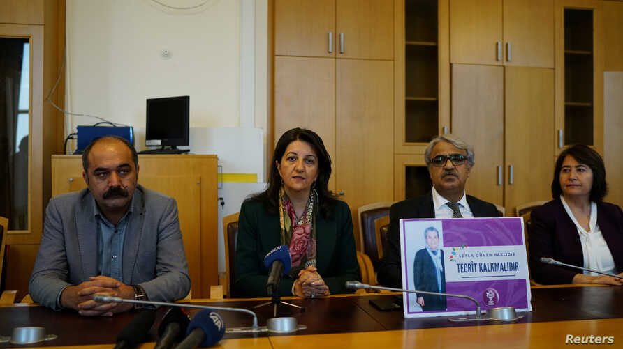 FILE - Pervin Buldan, co-leader of the pro-Kurdish People's Democratic Party, addresses reporters as she is accompanied by lawmakers before starting a two-day hunger strike in support of jailed Kurdish lawmaker Leyla Guven's own hunger strike against