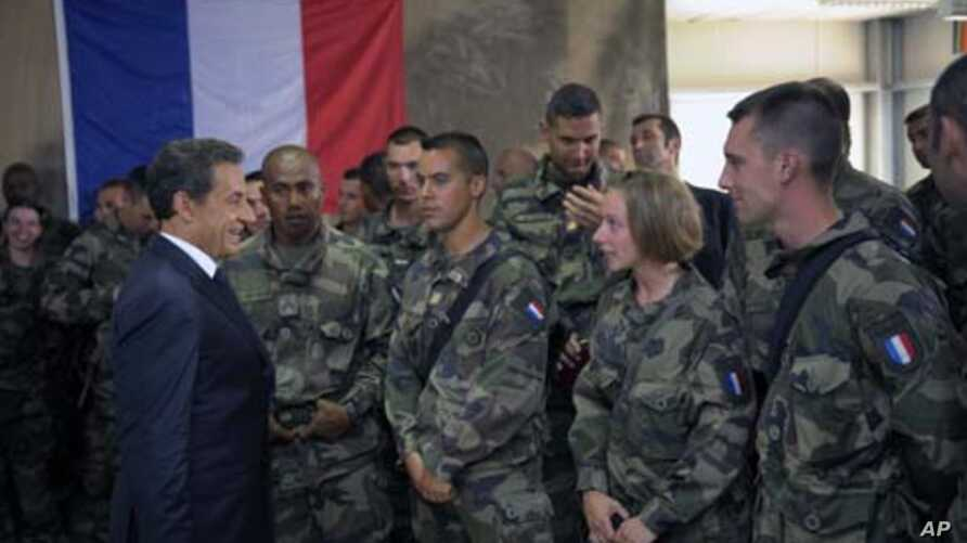 French President Nicolas Sarkozy talks to French troops at the 152nd Infantry Regiment military base in Tora in the region of Surobi, Afghanistan, July 12, 2011.
