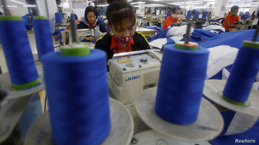 FILE - Laborers work at a garment factory in Hung Yen province, outside Hanoi January 5, 2017.