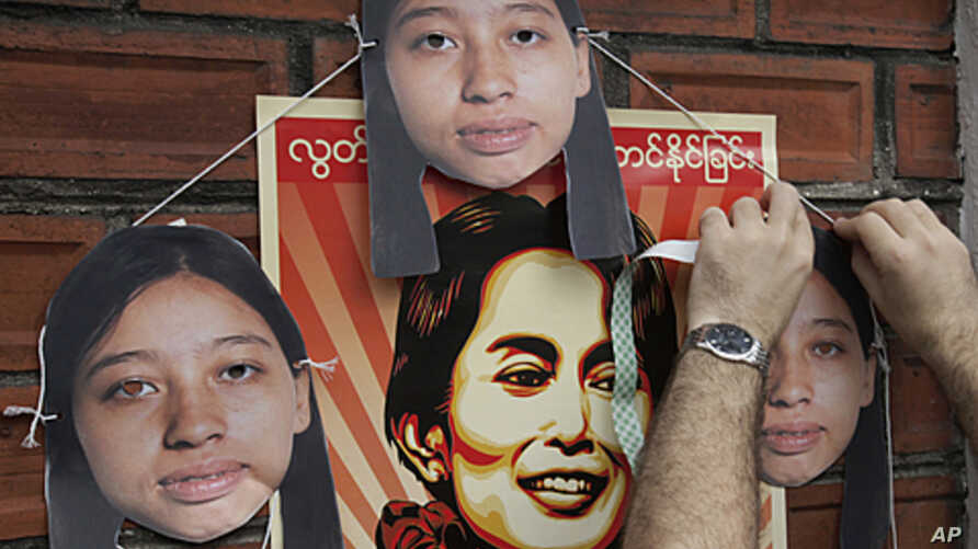 A Myanmar activist puts cutouts of imprisoned Hla Hla Win, a reporter of the Norway-based Democratic Voice of Burma, on a wall near Myanmar Embassy during a rally in Bangkok, Thailand, (File September 9, 2011).