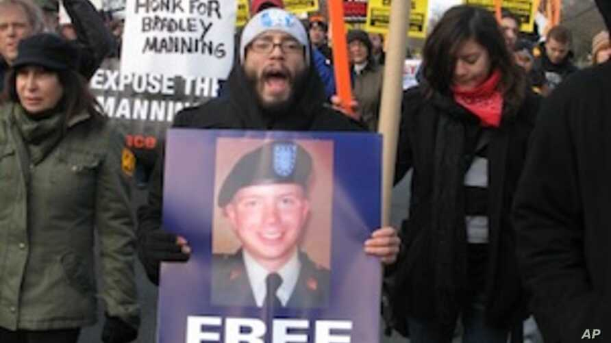 Protesters marched along the Fort Meade compound showing support for Bradley Manning in Fort Meade, Maryland, December 17, 2011.