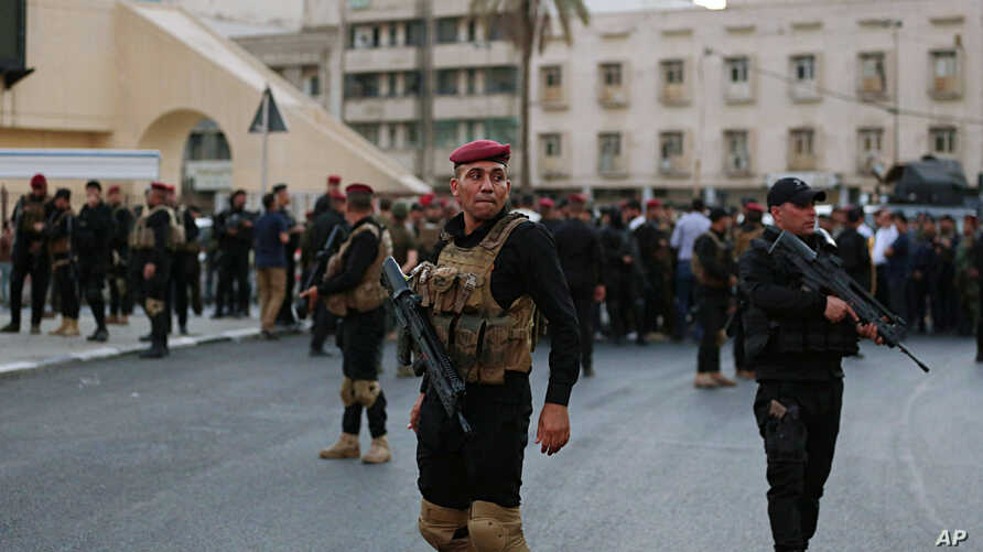 Iraqi security forces close a bridge leading to the heavily guarded Green Zone during protests demanding services and jobs in central Baghdad, Iraq, July 14, 2018.