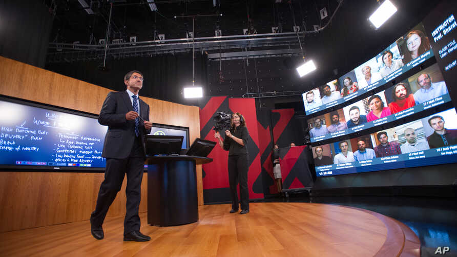 Harvard Business School Professor Bharat Anand demonstrates HBX Live, an online classroom that allows real-time discussion between professors and students from around the world.