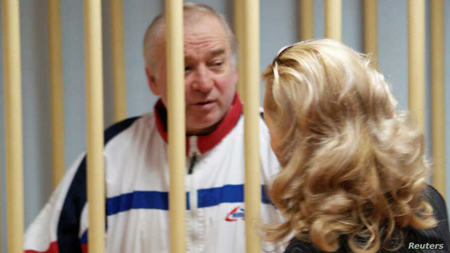 Sergei Skripal, a former colonel of Russia's GRU military intelligence service, looks on inside the defendants' cage as he attends a hearing at the Moscow military district court, Russia, Aug. 9, 2006.