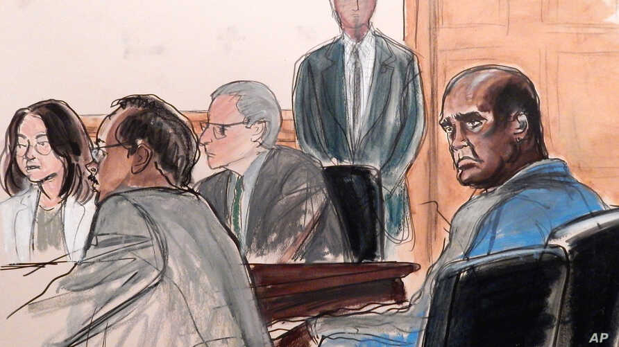 In this courtroom sketch, defendant John Ashe, right, sits in court during his arraignment on bribery charges in New York, Oct. 6, 2015.