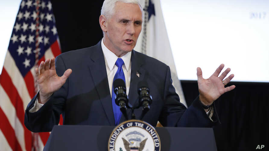FILE - Vice President Mike Pence participates in a listening session at the Eisenhower Executive Office Building on the White House complex in Washington.