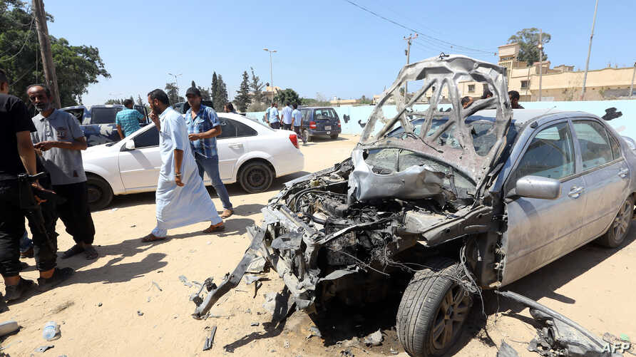 Libyans gather at the site of an attack on a checkpoint in the city of Zliten, 170 km east of the capital Tripoli, , Aug. 23, 2018. An attack on a checkpoint between the Libyan capital and the town of Zliten killed six soldiers of the UN-backed unity