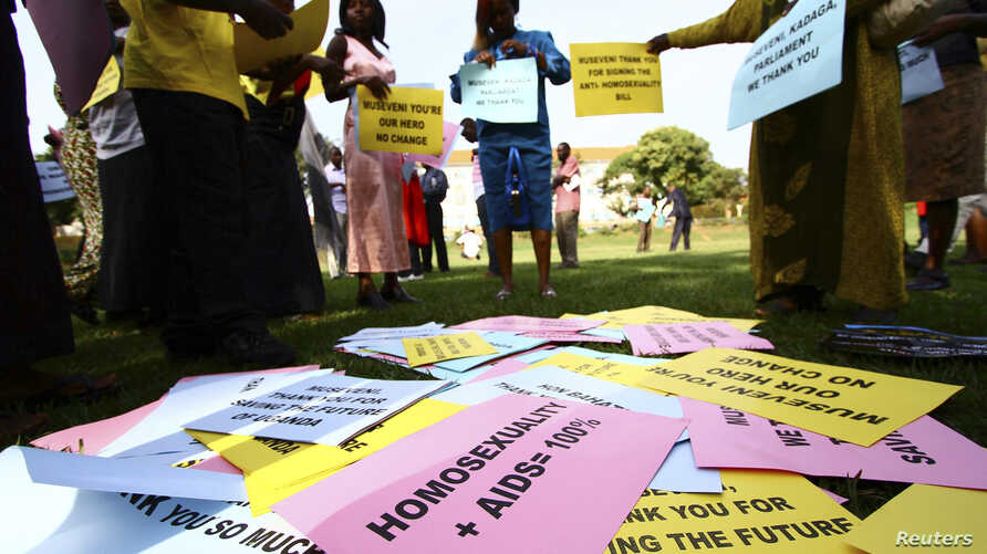 FILE - Supporters of the anti-gay law prepare for a procession backing the signing of the anti-gay bill into law, in Uganda's capital, Kampala.