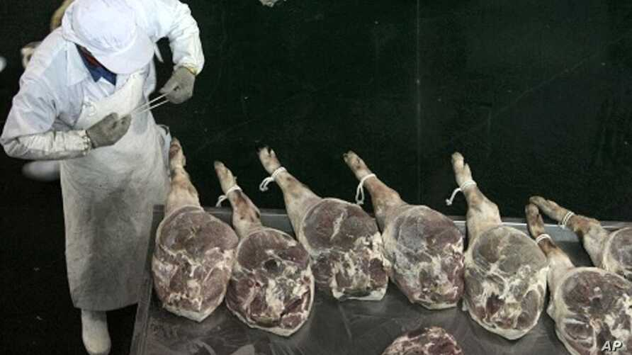 An employee at a workshop of a ham-processing factory in Jinhua, Zhejiang province April 10, 2011.