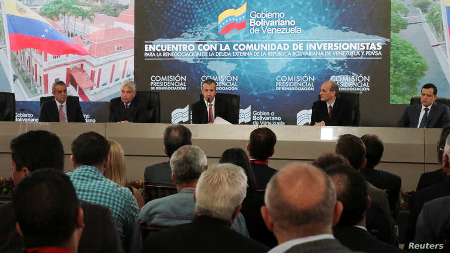 FILE - Venezuela's Vice President Tareck El Aissami (C) speaks during a meeting with bondholders and their representatives, next to Oil Minister Eulogio del Pino, Economy Vice President Wilmar Castro, Planning Minister Ricardo Menendez and Economy Mi