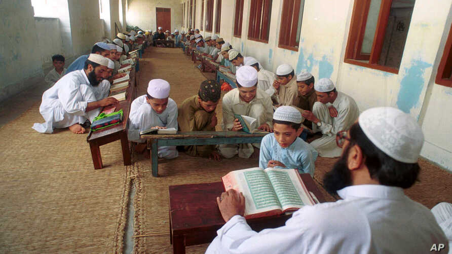 An undated photo of Pakistani children studying the Quran at a religious school in Lahore, Pakistan. Pakistan's religious schools, or madrassas, face renewed scrutiny with many alleging that the schools serve as breeding grounds for violent extremist