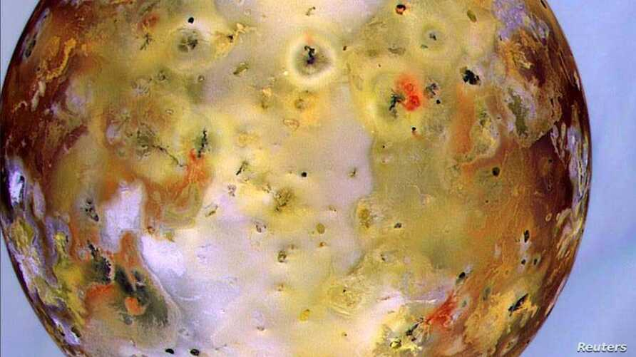"""Jupiter's moon Io, the most volcanic body in the solar system, is seen in front of Jupiter's cloudy atmosphere in this image made from NASA's Galileo spacecraft and released Oct. 24. NASA's Bradford Smith, who acted as the """"nation's tour guide"""" to ph"""