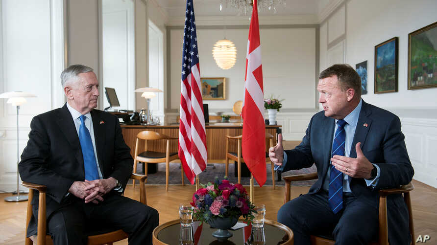Danish Prime Minister Lars Loekke Rasmussen (R) gestures during a meeting with United States Defense Minister, former General James Mattis (L) in the prime minister's office at Christiansborg Castle in Copenhagen, Denmark, May 9, 2017..